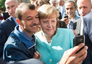 6a. Angela Merkel has a selfie taken with a refugee in Berlin - Bernd Von Jutrczenka-European Pressphoto Agency (2015)