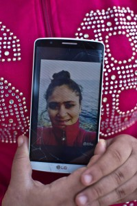 In this Saturday, Oct. 3, 2015 photo, Syrian refugee Lailav Khalil, 15, shows a selfie on her mobile phone, after arriving on a dinghy from the Turkish coast to the northeastern Greek island of Lesbos. (Muhammed Muheisen/AP For Time Magazine)
